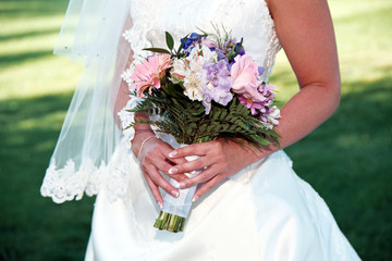 close up of bride holding pastel bouquet