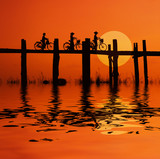 bikers on bridge with sunset poster