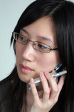 oriental woman on cell phone look left poster