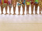 gymnasts in a row poster