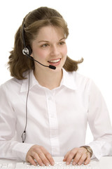 female receptionist with headphones, typing, commu