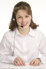 woman operator, keybording/typing with head phones