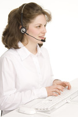 female receptionist with headphones, typing