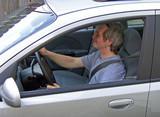 man driving car poster