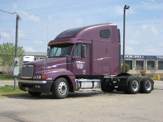 purple freightliner truck
