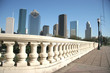 downtown houston viewed from a bridge sidewalk ove