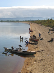 boats on a beach preparing to go on the lake, poso lake, sulawes