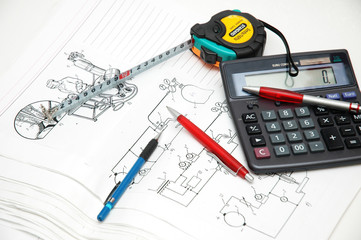 design drawings, calculator, pens and measuring tape