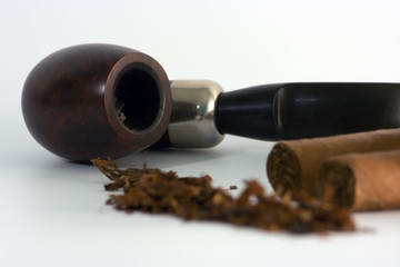 pipe with unfocussed cigars and tobacco
