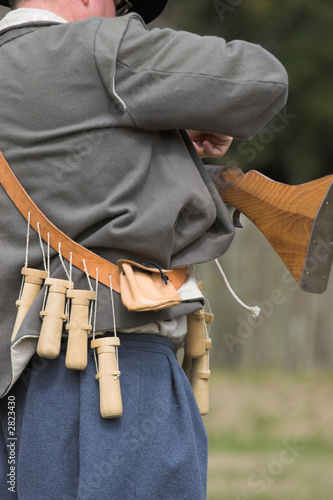 musketeer loading his weapon