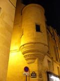 façade médiviale du quartier latin le soir. poster