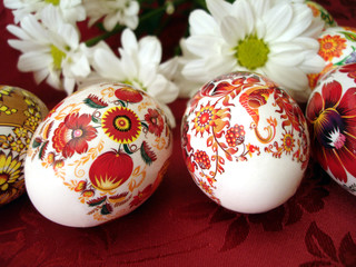 beautiful red easter eggs with white flowers