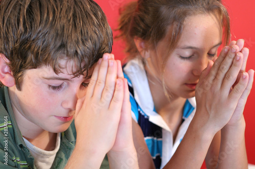 boy & girl praying together