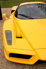 front side of yellow supercar