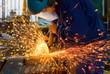 Leinwandbild Motiv men at work grinding steel