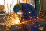 men at work grinding steel poster