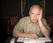 bored man looking at computer