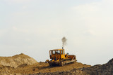 bulldozer on sand heap poster