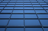 blue glass panels of a skyscraper poster