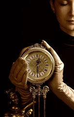 sepia picture of a beutiful girl with a clock (focus on clock)