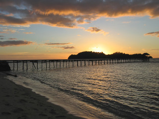 sunset over a beach tropical, togians island, sulawesi, indonesi
