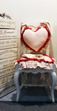 chair with a heart shaped pillow poster