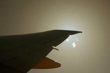 sun behind a wing