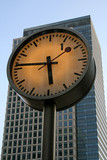 clock in front of office building poster