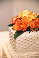 orange and yellow roses wedding cake