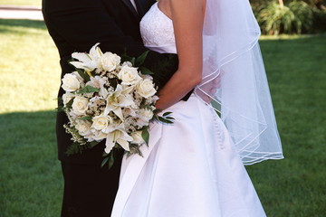 bridal couple with cream rose bouquet