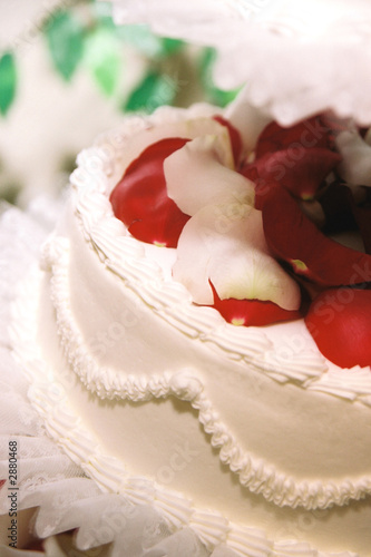 close up of red roses on wedding cake