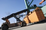 giant forklift lifting container poster