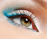green eye with blue eyeshadows poster