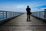 man looking at open ocean vista poster