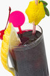 dark drink with citron and cherry on white backgro