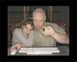 man and woman at computer