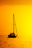 yacht silhouette in sunset light poster