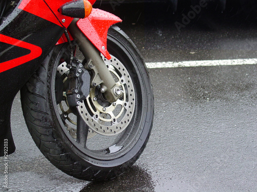 motorcycle tire in the rain - 2922033