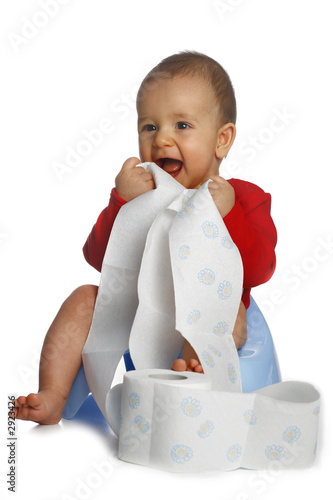 baby with unrolled papper
