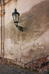 classic street lamp on the old wall