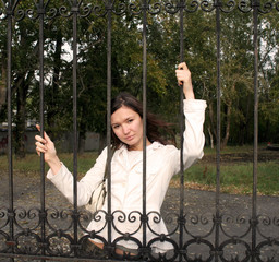 girl behind bars