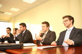 five business persons at a conference,interview poster