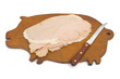 pork and knife on pig shaped board