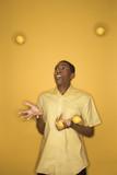 african-american man juggling lemons. poster