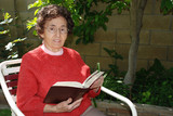 grandmother with bible in garden poster