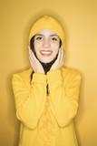 caucasian woman wearing yellow raincoat. poster