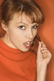 caucasian woman on orange background. poster