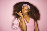 young african-american woman holding fuzzy dice. poster