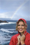 woman by ocean and rainbow in maui, hawaii. poster