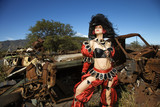 woman dressed as pirate in junkyard. poster
